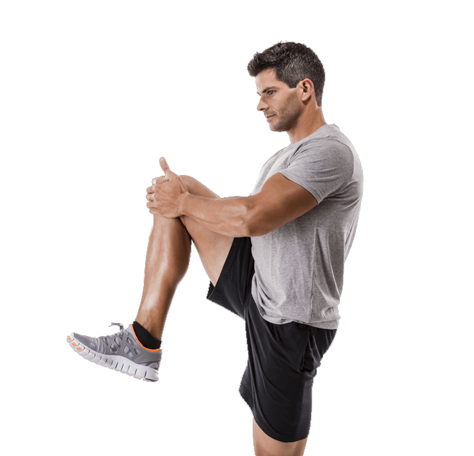 Young, athletic man doing knee stretch before or after exercising.